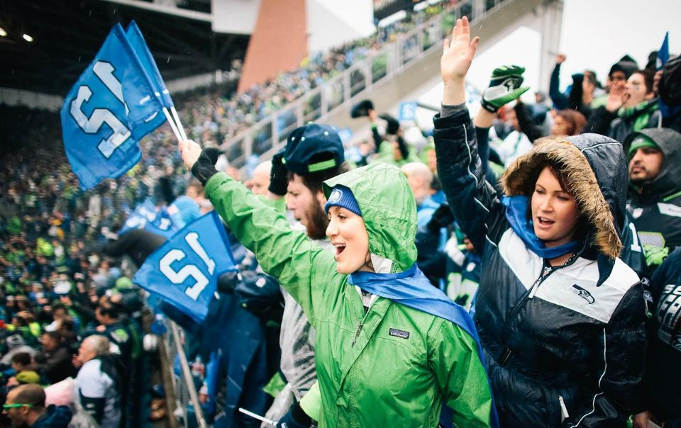 "Seahawks fan holds ""12"" flag created by BDA"
